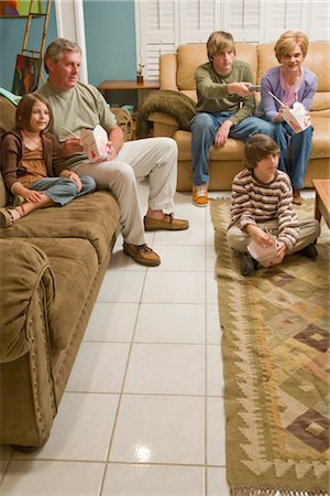 Family eating Chinese takeout in living room watching TV Stock Photo - Rights-Managed, Code: 842-02651516
