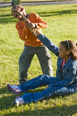 Portrait of African American boy and girl playing outdoors in park Stock Photo - Rights-Managed, Code: 842-02651707