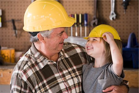 Happy grandfather and grandson wearing hard hats Stock Photo - Rights-Managed, Code: 842-02652027