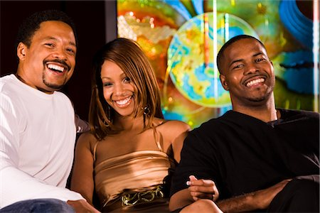 Portrait of three young African American people sitting at nightclub, low angle view Stock Photo - Rights-Managed, Code: 842-02652470