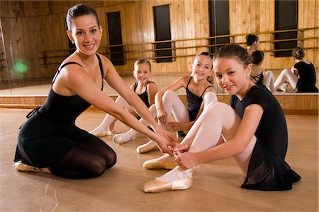 Portrait of ballet dancers (8-9) sitting on floor with instructor in dance studio with mirror in background Stock Photo - Rights-Managed, Code: 842-02652909