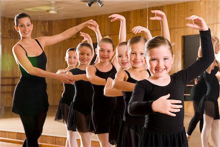 Portrait of ballet dancers (8-9) practicing while teacher instructing in dance studio with mirror in background Stock Photo - Rights-Managed, Code: 842-02652902