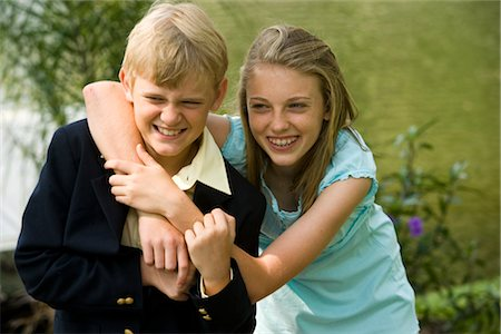 Closeup portrait of brother and sister hugging and smiling Stock Photo - Rights-Managed, Code: 842-02653608
