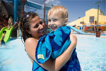 Close-up of mother carrying son wrapped in towel at water park Stock Photo - Rights-Managed, Code: 842-02653643
