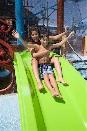 Mother and son sliding down water slide together at water park Stock Photo - Rights-Managed, Code: 842-02653657