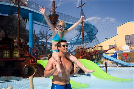 Portrait of father carrying daughter on shoulders at water park Stock Photo - Rights-Managed, Code: 842-02653665
