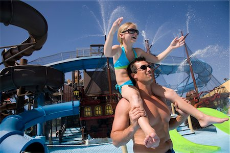 Portrait of father carrying daughter on shoulders at water park Stock Photo - Rights-Managed, Code: 842-02653666