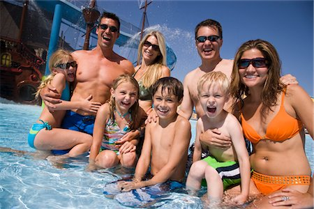 Portrait of family and friends having fun at water park Stock Photo - Rights-Managed, Code: 842-02653667