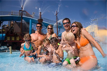 Portrait of family and friends having fun at water park Stock Photo - Rights-Managed, Code: 842-02653669