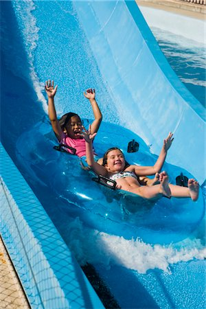 Portrait of girls sliding on water slide in water park Stock Photo - Rights-Managed, Code: 842-02653678