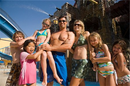 Portrait of family and friends at water park Stock Photo - Rights-Managed, Code: 842-02653684