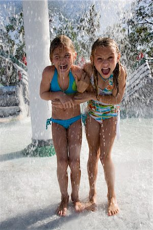 Girls dancing in splashing water at water park Stock Photo - Rights-Managed, Code: 842-02653695