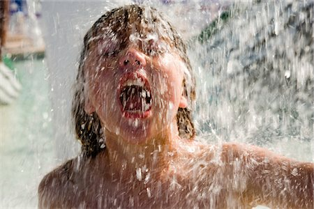 Boy in splashing water at water park Stock Photo - Rights-Managed, Code: 842-02653693