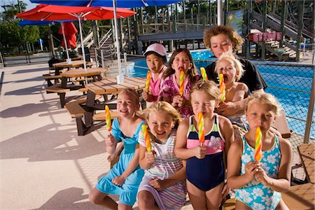preteen girl licking - Children eating lollipop in water park Stock Photo - Rights-Managed, Code: 842-02653718