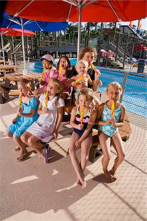 preteen girl licking - Group of children enjoying popsicles at water park Stock Photo - Rights-Managed, Code: 842-02653710
