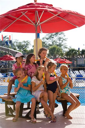 preteen girl licking - Group of children enjoying popsicles at water park Stock Photo - Rights-Managed, Code: 842-02653756