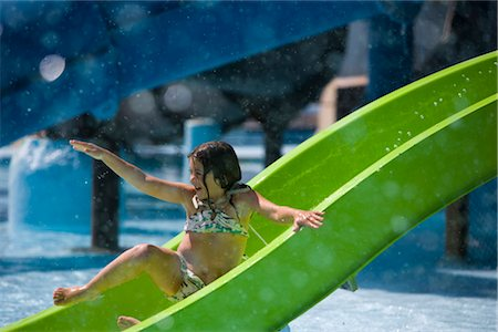 Girl sliding down waterslide at water park Stock Photo - Rights-Managed, Code: 842-02653773