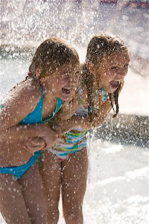 Girls shouting in splashing water at water park Stock Photo - Rights-Managed, Code: 842-02653809