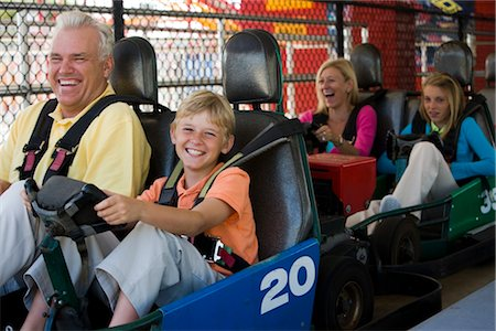 Family riding go-carts at an amusement park Stock Photo - Rights-Managed, Code: 842-02653936