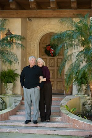 Portrait of senior couple standing in front of luxurious home Stock Photo - Rights-Managed, Code: 842-02754460