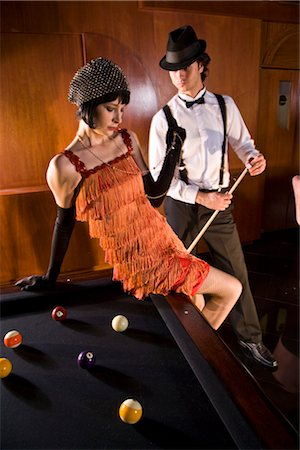 Portrait of 1920s socialite couple at billiards table 1920s bar Stock Photo - Rights-Managed, Code: 842-02754559