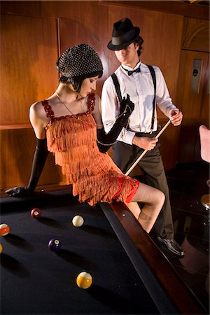 Portrait of 1920s socialite couple at billiards table 1920s bar Stock Photo - Rights-Managed, Code: 842-02754560