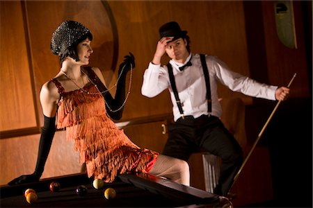 Portrait of 1920s socialite couple at billiards table 1920s bar Stock Photo - Rights-Managed, Code: 842-02754631