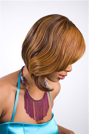 seamless - Side view of young stylish African American woman, studio shot Stock Photo - Rights-Managed, Code: 842-02751666
