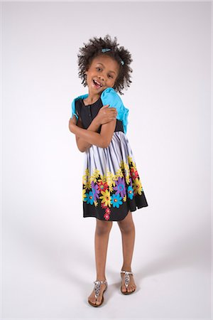 seamless floral - Portrait of young African American girl hugging herself, studio shot Stock Photo - Rights-Managed, Code: 842-02751661