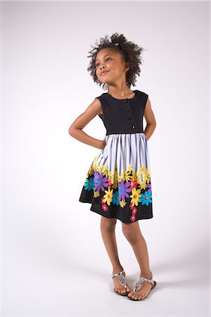 seamless - Portrait of young African American girl in dress, studio shot Stock Photo - Rights-Managed, Code: 842-02751662