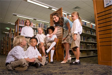 Elementary school teacher teaching pupils in library Stock Photo - Rights-Managed, Code: 842-02751787