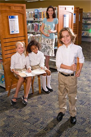 Portrait of elementary school teacher with pupils in library Stock Photo - Rights-Managed, Code: 842-02751781