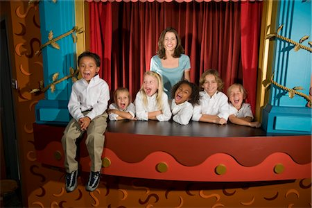 Elementary school teacher and pupils in library theatre Stock Photo - Rights-Managed, Code: 842-02751799
