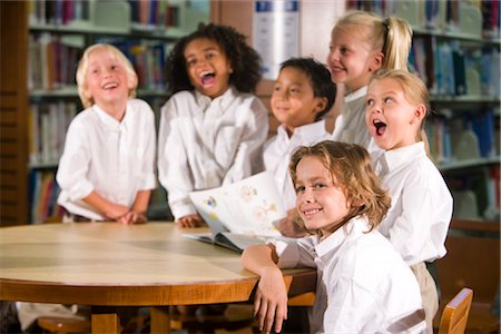 Six elementary school children smiling at table in library Stock Photo - Rights-Managed, Code: 842-02751871