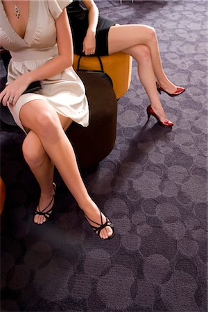 sexy women legs - Cropped view of sexy women sitting in waiting room Stock Photo - Rights-Managed, Code: 842-02752037