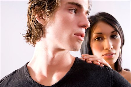 sad lovers break up - Close-up of serious young man glancing back at young woman Stock Photo - Rights-Managed, Code: 842-02752048