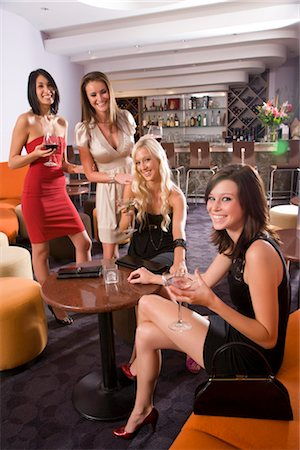 Portrait of young women drinking wine and martinis in restaurant bar Stock Photo - Rights-Managed, Code: 842-02752042
