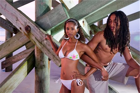 Portrait of young Jamaican couple standing under pier Stock Photo - Rights-Managed, Code: 842-02752216