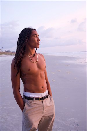 Portrait of young Jamaican man with dreadlocks standing on beach Stock Photo - Rights-Managed, Code: 842-02752220