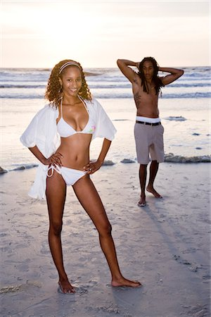 Young Jamaican man standing on beach checking out woman in bikini Stock Photo - Rights-Managed, Code: 842-02752238