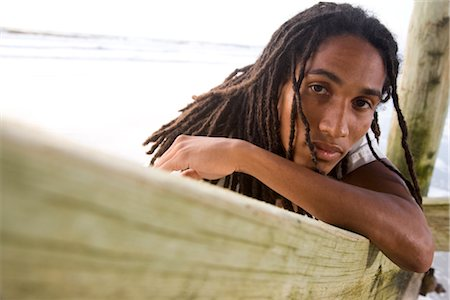 Portrait of young Jamaican man leaning on beach pier, looking at camera Stock Photo - Rights-Managed, Code: 842-02752247