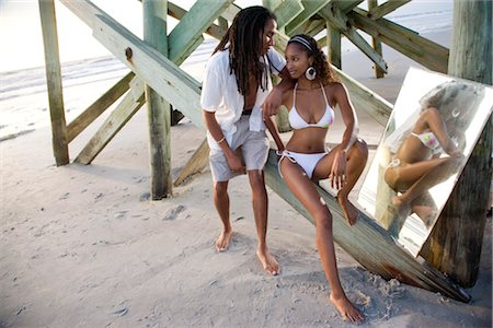 Portrait of young Jamaican couple sitting on beach pier with mirror Stock Photo - Rights-Managed, Code: 842-02752241