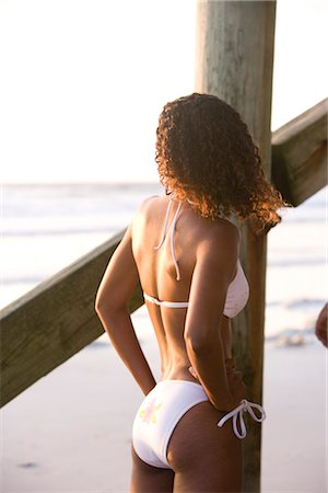 sexy black women in bikinis - Rear view of young sexy Jamaican woman in bikini standing beside beach pier Stock Photo - Rights-Managed, Code: 842-02752276