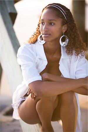sexy black women in bikinis - Portrait of young sexy Jamaican woman kneeling beside beach pier Stock Photo - Rights-Managed, Code: 842-02752286