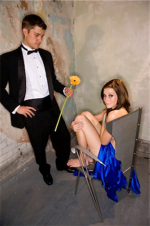 Portrait of young man in tuxedo handing nude woman in chair a flower Stock Photo - Rights-Managed, Code: 842-02752338