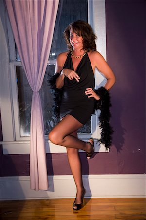 Portrait of happy sexy hooker standing near window with cigarette Stock Photo - Rights-Managed, Code: 842-02753056