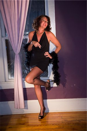 Portrait of happy sexy hooker standing near window with cigarette Stock Photo - Rights-Managed, Code: 842-02753057