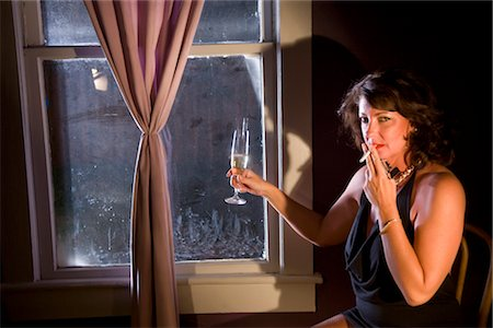 Portrait of sexy hooker with champagne and cigarette Stock Photo - Rights-Managed, Code: 842-02753050