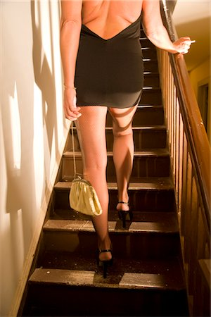 sexy women legs - Rear view of hooker walking up stairs in house Stock Photo - Rights-Managed, Code: 842-02753061