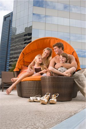 Portrait of family lounging poolside on rooftop terrace in the city Stock Photo - Rights-Managed, Code: 842-02753197